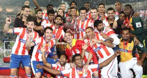 Kolkata celebrate with the winners trophy during the final of the Hero Indian Super League between Kerala Blasters FC and Atletico de Kolkata held at the D.Y. Patil Stadium, Navi Mumbai, India on the 20th December 2014.  Photo by:  Shaun Roy / ISL/ SPORTZPICS