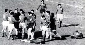 "World Cup Finals, 1962. Santiago, Chile. 2nd June, 1962. Italy 0 v Chile 2.  English referee Ken Aston tries to bring order after fighting broke out between Italian and Chilean players during their group two match dubbed as ""The Battle of Santiago"".  Chile's Sanchez (11) lies injured after being fouled by an Italian player"